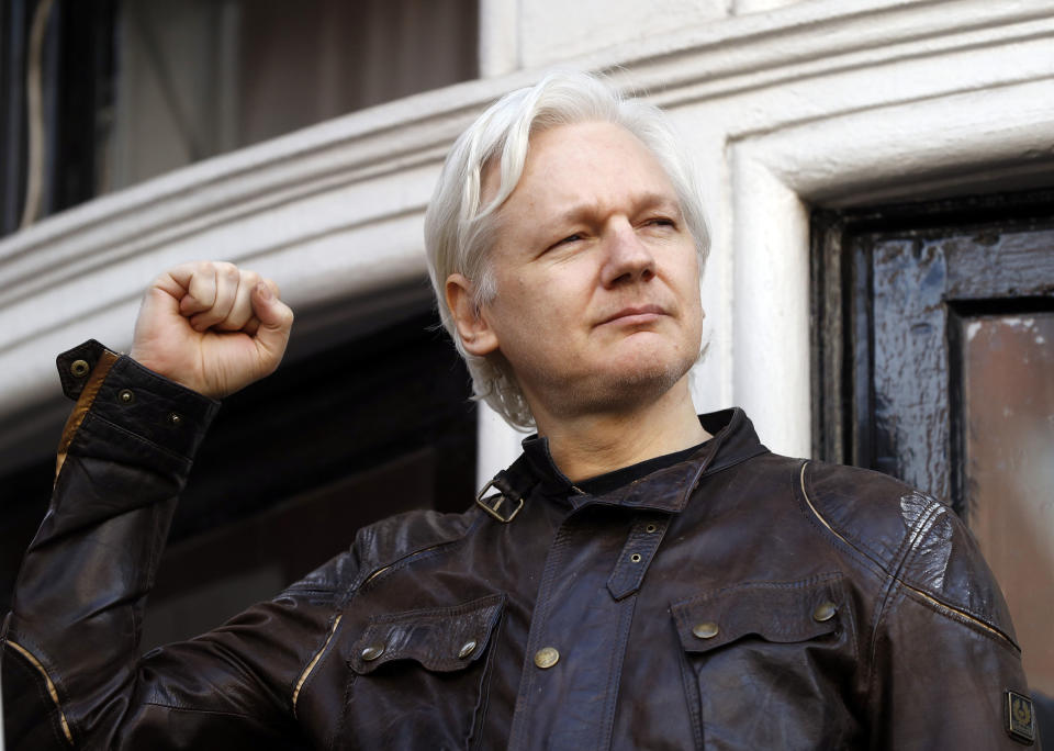 Julian Assange greets supporters outside the Ecuadorian embassy in London on May 19, 2017. (Frank Augstein/AP)