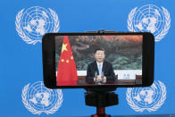 """Chinese President Xi Jinping is seen on a video screen remotely addressing the 75th session of the United Nations General Assembly, Tuesday, Sept. 22, 2020, at U.N. headquarters. This year's annual gathering of world leaders at U.N. headquarters will be almost entirely """"virtual."""" Leaders have been asked to pre-record their speeches, which will be shown in the General Assembly chamber, where each of the 193 U.N. member nations are allowed to have one diplomat present. (AP Photo/Mary Altaffer)"""