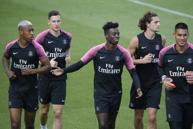 Unsurprisingly, 18-year-old American forward Tim Weah (C) has found playing time hard to come by this season at star-studded Paris Saint-Germain. (AP Photo/Michel Euler)
