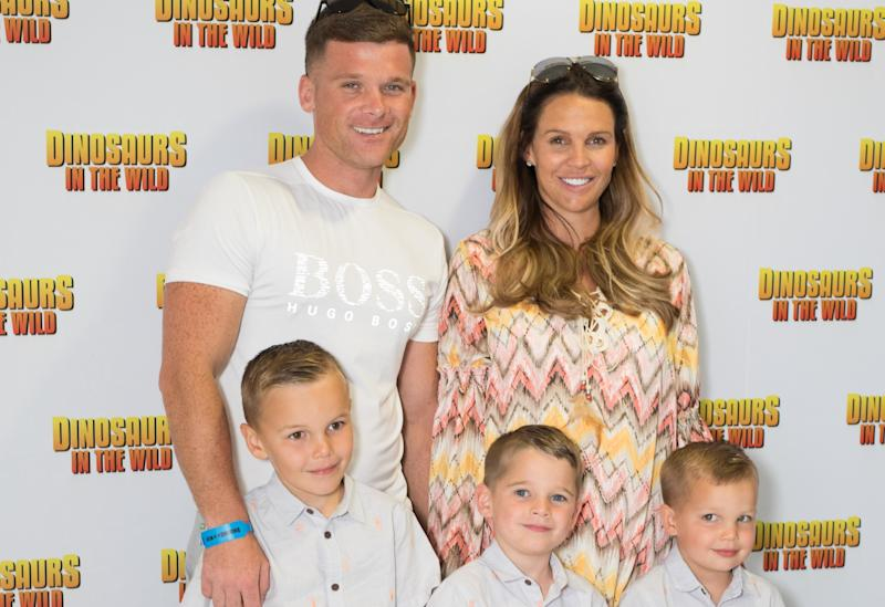 Danielle Lloyd and husband Michael O'Neill with her eldest sons sons Archie, Harry and George. (PA)