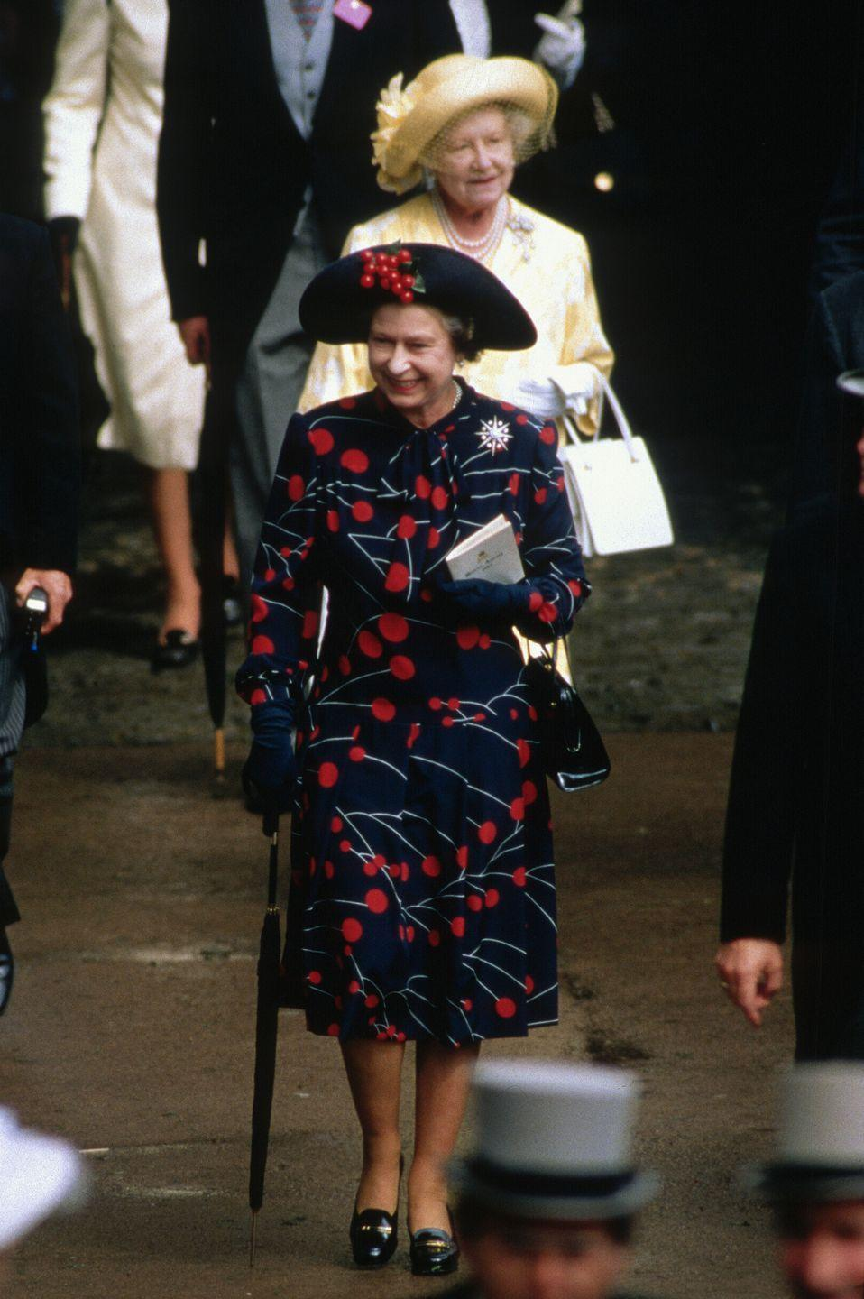 <p>The Royal Ascot horse race always provides great unusual outfit fodder. The Queen wore a cherry print and matching hat (with 3D cherries) to the 1990 event. </p>