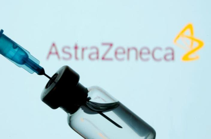 FILE PHOTO: FILE PHOTO: Vial and sryinge are seen in front of displayed AstraZeneca logo