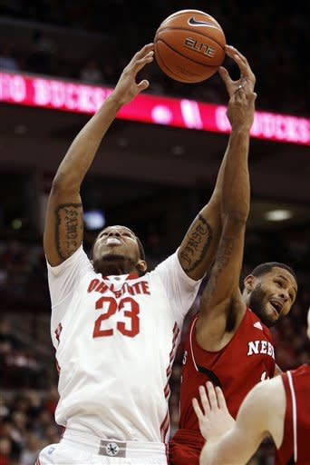 Ohio State's Amir Williams (23) works for a rebound against Nebraska's Ray Gallegos during the first half of an NCAA college basketball game in Columbus, Ohio, Wednesday, Jan. 2, 2013. (AP Photo/Paul Vernon)