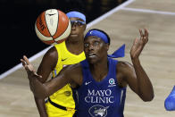 Minnesota Lynx center Sylvia Fowles (34) reaches for the ball in front of Chicago Sky guard Diamond DeShields (1) during the first half of a WNBA basketball game Thursday, July 30, 2020, in Bradenton, Fla. (AP Photo/Chris O'Meara)