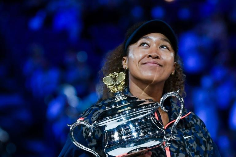 Four-time major champion: Naomi Osaka poses with the Daphne Akhurst Memorial Cup after defeating Jennifer Brady in the Australian Open final