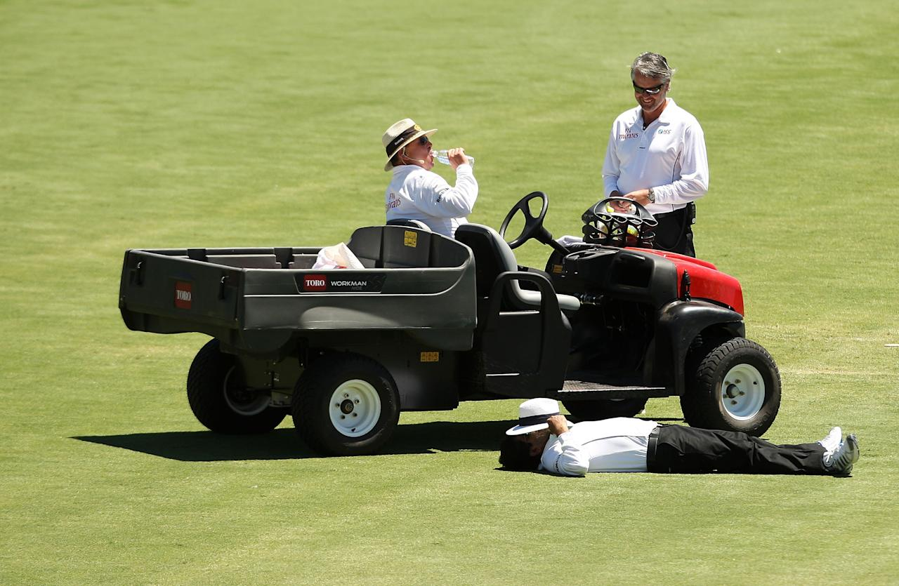 ADELAIDE, AUSTRALIA - DECEMBER 06:  Umpire Asad Rauf lies down during a drinks break on day three of the Second Test match between Australia and the West Indies at Adelaide Oval on December 6, 2009 in Adelaide, Australia.  (Photo by Mark Kolbe/Getty Images)