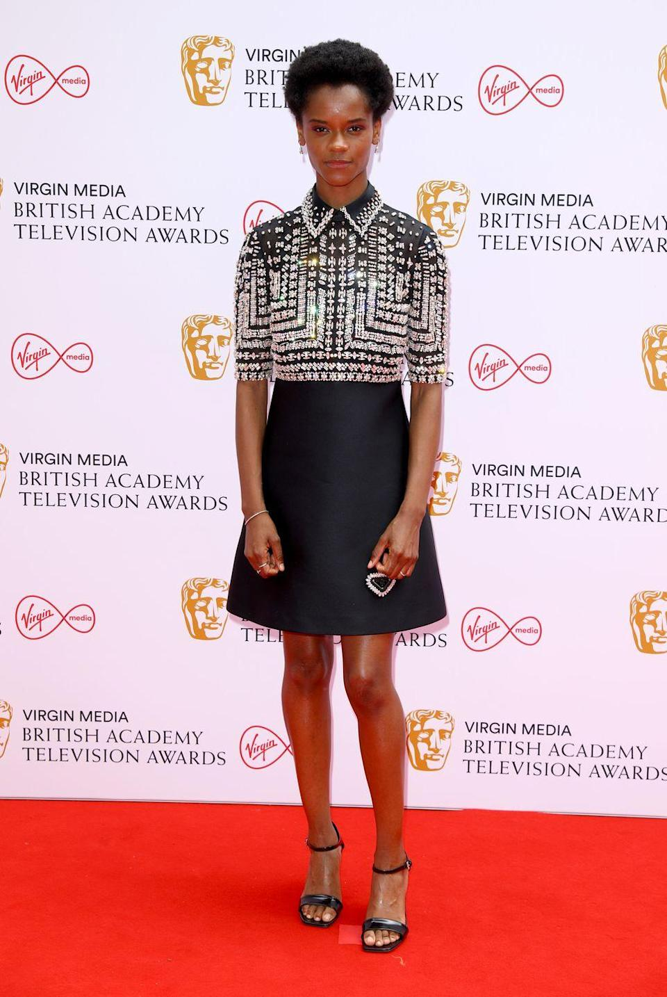 <p>Letitia Wright brought some dazzle to the red carpet, wearing a bejewelled mini dress by Prada, which she teamed with strappy sandals.</p>