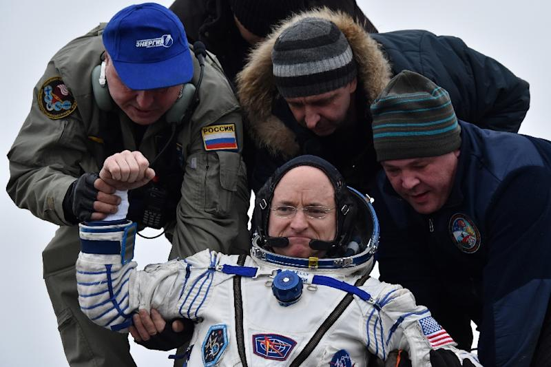 International Space Station crew member Scott Kelly, a veteran of four space missions, returned to Earth with the record for the longest amount of time spent in space by an American -- 520 days (AFP Photo/Kirill Kudryavtsev)