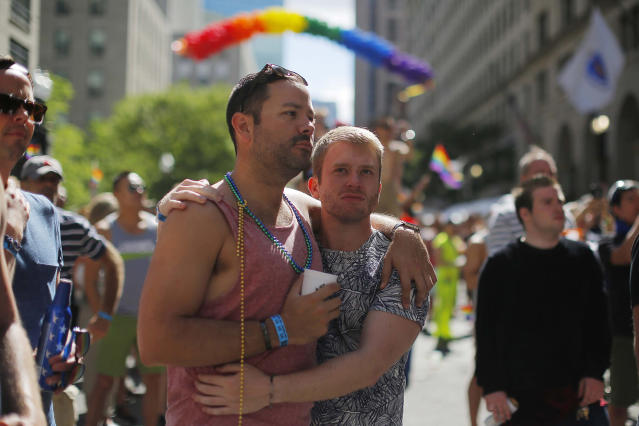 <p>Chris Hemming (L) and Tristan Davison join in a moment of silence for the victims of the mass shooting at Orlando's Pulse nightclub during a Pride Month block party in Boston, Massachusetts, June 12, 2016. (REUTERS/Brian Snyder) </p>