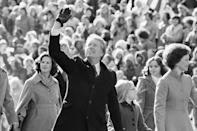 President Jimmy Carter waves to the crowd while walking with his wife, Rosalynn, and their daughter, Amy, along Pennsylvania Avenue from the Capitol to the White House following his inauguration in Washington, Jan. 20, 1977. (AP Photo/Suzanne Vlamis)