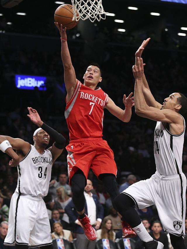 Houston Rockets guard Jeremy Lin (7) shoots against Brooklyn Nets guard Shaun Livingston (14) as forward Paul Pierce (34) looks on during the second half of their NBA basketball game at the Barclays Center, Tuesday, April 1, 2014, in New York. (AP Photo/John Minchillo)