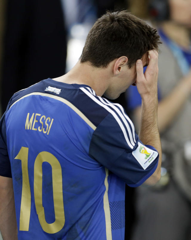 Argentina's Lionel Messi holds his head following Germany's 1-0 victory over Argentina after the World Cup final soccer match between Germany and Argentina at the Maracana Stadium in Rio de Janeiro, Brazil, Sunday, July 13, 2014. (AP Photo/Natacha Pisarenko)
