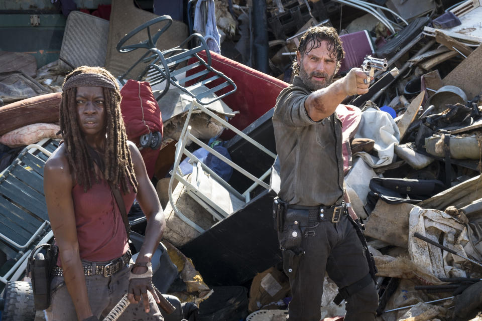 """In this image released by AMC, Danai Gurira, left, and Andrew Lincoln appear in a scene from """"The Walking Dead."""" (Gene Page/AMC via AP)"""