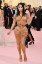 Kim Kardashian once again stepped out in a memorable Met Gala look, which showed off her famous figure. Matching a corset to her signature 'wet hair' tresses, Kim turned heads upon arrival. Photo: Getty Images