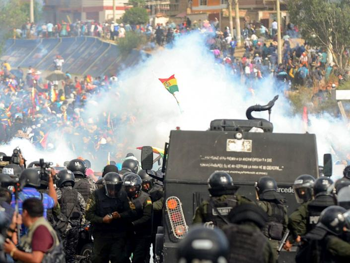 Bolivian riot police clash with supporters of ex-president Evo Morales during a protest against the interim government in Sacaba: AFP via Getty Images