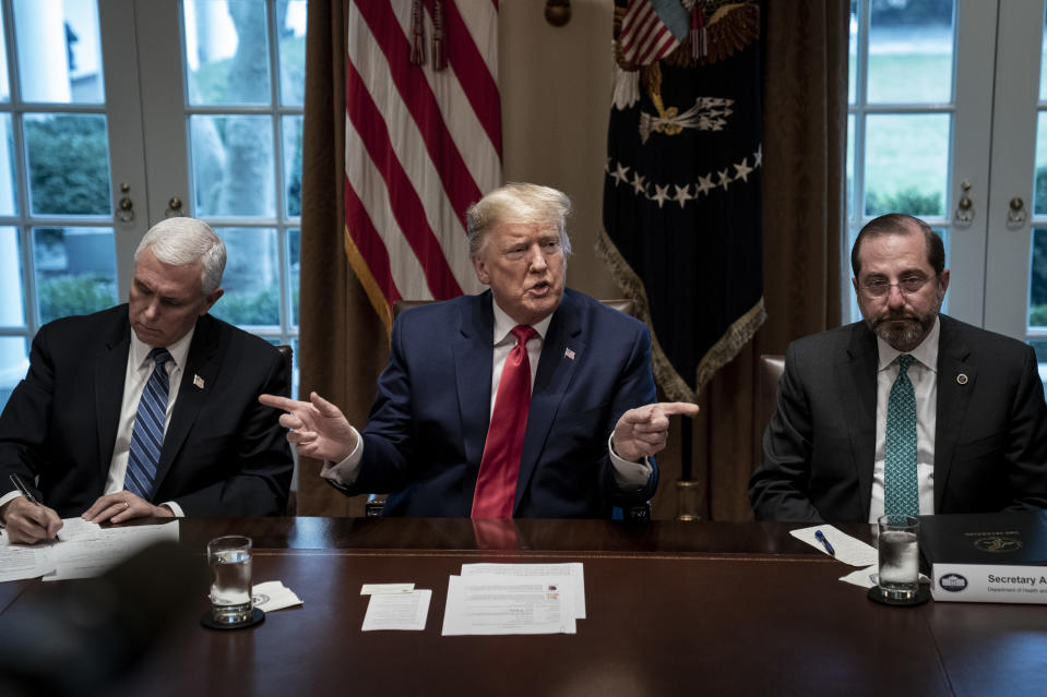 Flanked by U.S. Vice President Mike Pence (L) and Secretary of Health and Human Services Alex Azar, U.S. President Donald Trump speaks  during a meeting with the White House Coronavirus Task Force and pharmaceutical executives in Cabinet Room of the White House on March 2, 2020 in Washington, DC. (Drew Angerer/Getty Images)
