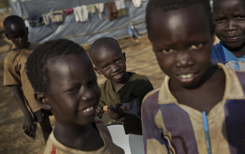 Young displaced boys play at a United Nations compound which has become home to thousands of people displaced by the recent fighting, in the Jebel area on the outskirts of Juba, South Sudan Tuesday, Dec. 31, 2013. Anti-government rebels took control of nearly all of the strategic city of Bor on Tuesday even as officials announced that representatives from the government and the rebels had agreed to hold talks for the first time. (AP Photo/Ben Curtis)
