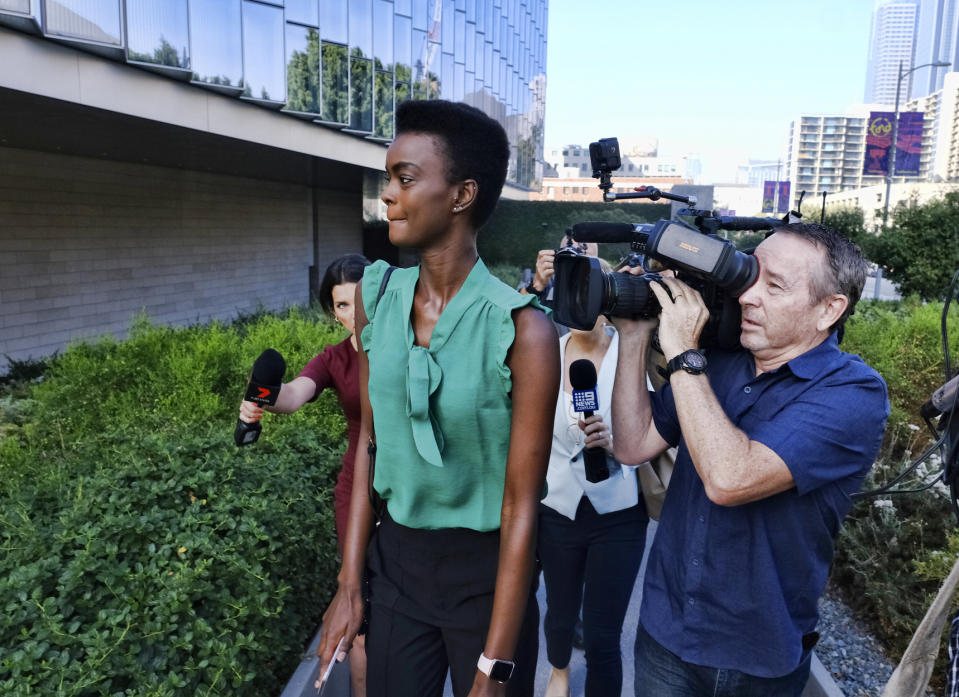 Pictured is the model and former Miss World Australia finalist Mornyang surrounded by journalists in LA.