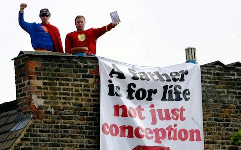 Campaigners from Fathers 4 Justice stand on the roof of the home of former Labour Party deputy leader, Harriet Harman - Credit: REUTERS/Luke MacGregor