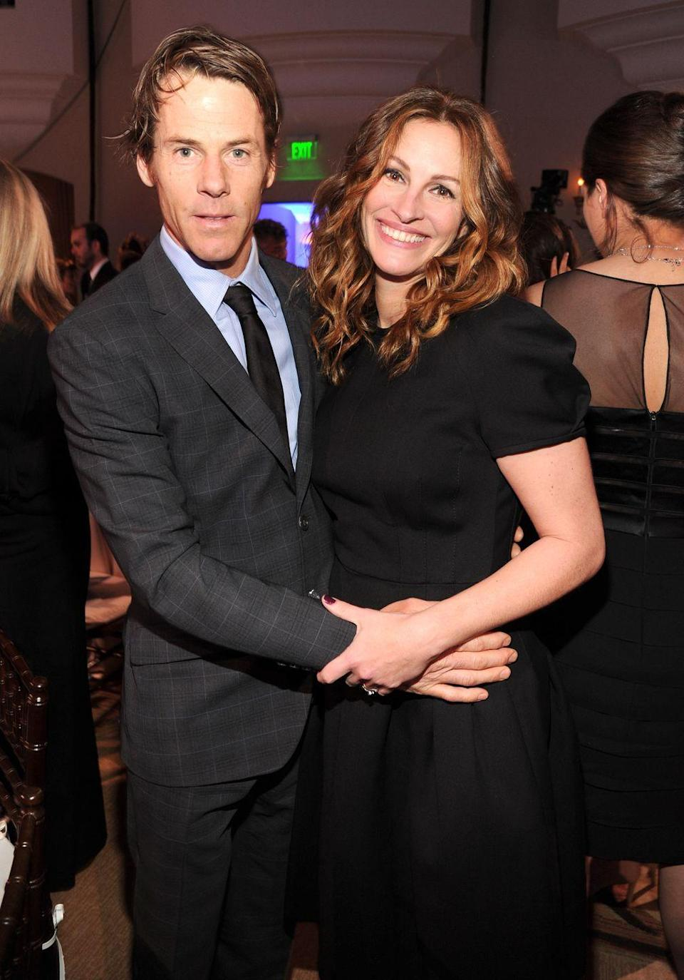 """<p>Roberts and Mode married in 2002. They have three children together<a href=""""https://www.elle.com/uk/life-and-culture/a37045192/julia-roberts-children-husband/"""" rel=""""nofollow noopener"""" target=""""_blank"""" data-ylk=""""slk:with their daughter Hazel recently making her red carpet debut,"""" class=""""link rapid-noclick-resp""""> with their daughter Hazel recently making her red carpet debut,</a> with her father, at Cannes Film Festival.</p>"""
