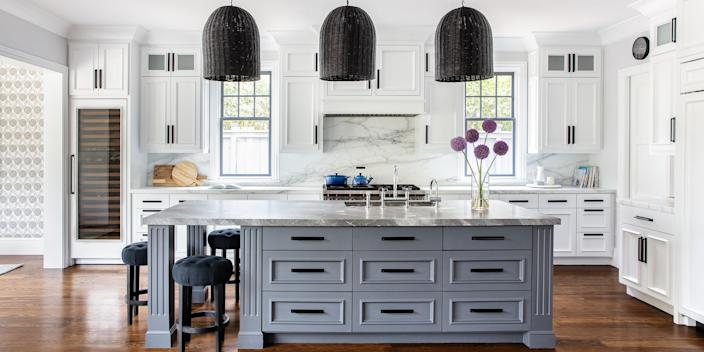 Adding a pop of color, even if it's just on an island, can give your kitchen some personality. (Thomas Kuoh)