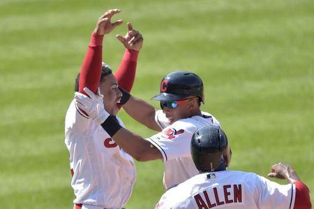 Aug 9, 2018; Cleveland, OH, USA; Cleveland Indians left fielder Michael Brantley, center, celebrates his game-winning hit against the Minnesota Twins with shortstop Francisco Lindor, left, and center field Greg Allen at Progressive Field. Mandatory Credit: David Richard-USA TODAY Sports