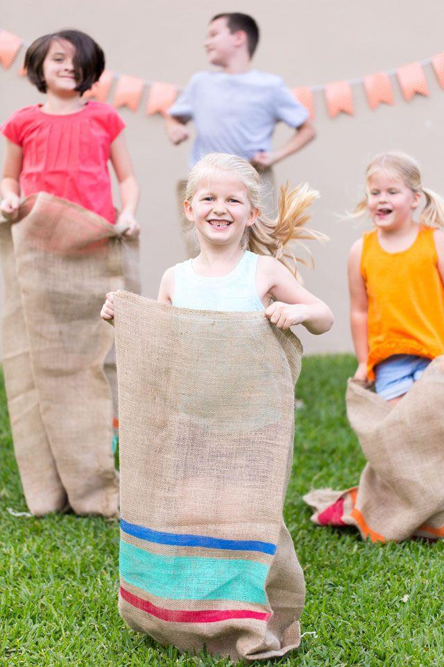 """<p>You can bring this fun idea to life with burlap sacks, acrylic craft paint, and painter's tape. Hop to it! </p><p><strong>Get the tutorial at <a href=""""https://designimprovised.com/2016/05/field-day-party-diy-painted-potato-sacks.html"""" rel=""""nofollow noopener"""" target=""""_blank"""" data-ylk=""""slk:Design Improvised"""" class=""""link rapid-noclick-resp"""">Design Improvised</a>. </strong></p><p><a class=""""link rapid-noclick-resp"""" href=""""https://www.amazon.com/ARTY-KRAFTS-Staining-Premium-Painting/dp/B091FPZBJ1/?tag=syn-yahoo-20&ascsubtag=%5Bartid%7C2164.g.36687460%5Bsrc%7Cyahoo-us"""" rel=""""nofollow noopener"""" target=""""_blank"""" data-ylk=""""slk:SHOP FOAM BRUSHES"""">SHOP FOAM BRUSHES</a></p>"""