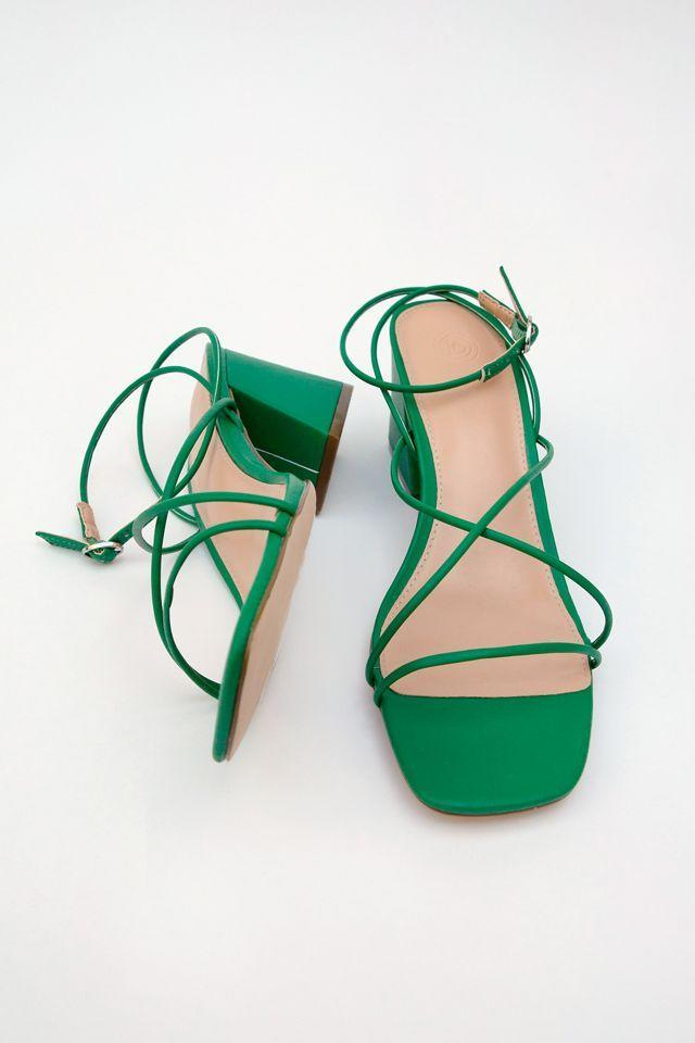 """<br><br><strong>Urban Outfitters</strong> Cindy Strappy Heel, $, available at <a href=""""https://go.skimresources.com/?id=30283X879131&url=https%3A%2F%2Fwww.urbanoutfitters.com%2Fshop%2Fuo-cindy-strappy-heel%3Fcategory%3Dwomens-sandals%26color%3D030%26type%3DREGULAR%26quantity%3D1"""" rel=""""nofollow noopener"""" target=""""_blank"""" data-ylk=""""slk:Urban Outfitters"""" class=""""link rapid-noclick-resp"""">Urban Outfitters</a>"""