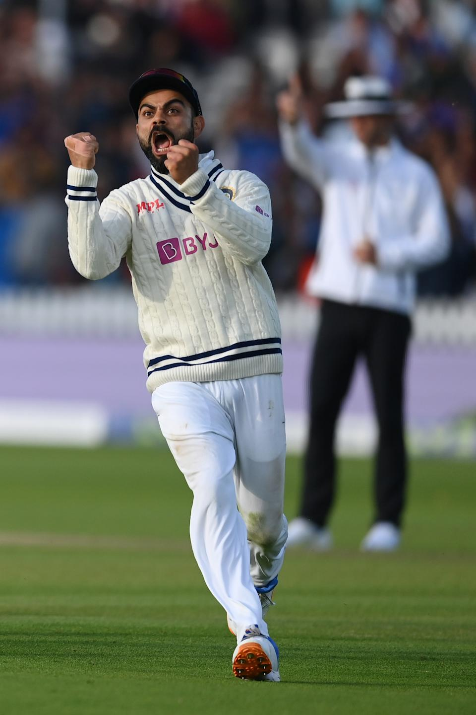 <p>LONDON, ENGLAND - AUGUST 16: Virat Kohli of India celebrates the crucial wicket of Jos Buttler of England during the Second LV= Insurance Test Match: Day Five between England and India at Lord's Cricket Ground on August 16, 2021 in London, England. (Photo by Mike Hewitt/Getty Images)</p>