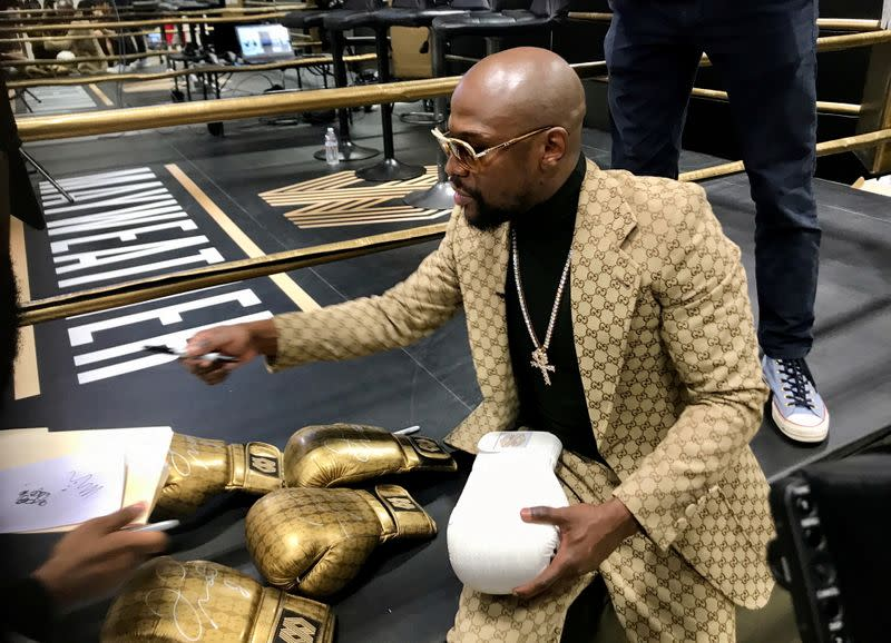FILE PHOTO: Floyd Mayweather signs gloves at the opening of the Mayweather Boxing + Fitness gym in Torrance
