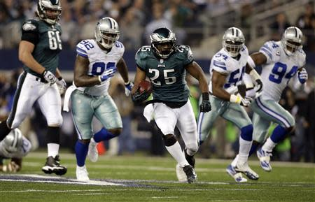 Dec 29, 2013; Arlington, TX, USA; Philadelphia Eagles running back LeSean McCoy (25) runs with the ball in the first quarter against the Dallas Cowboys at AT&T Stadium. Mandatory Credit: Tim Heitman-USA TODAY Sports