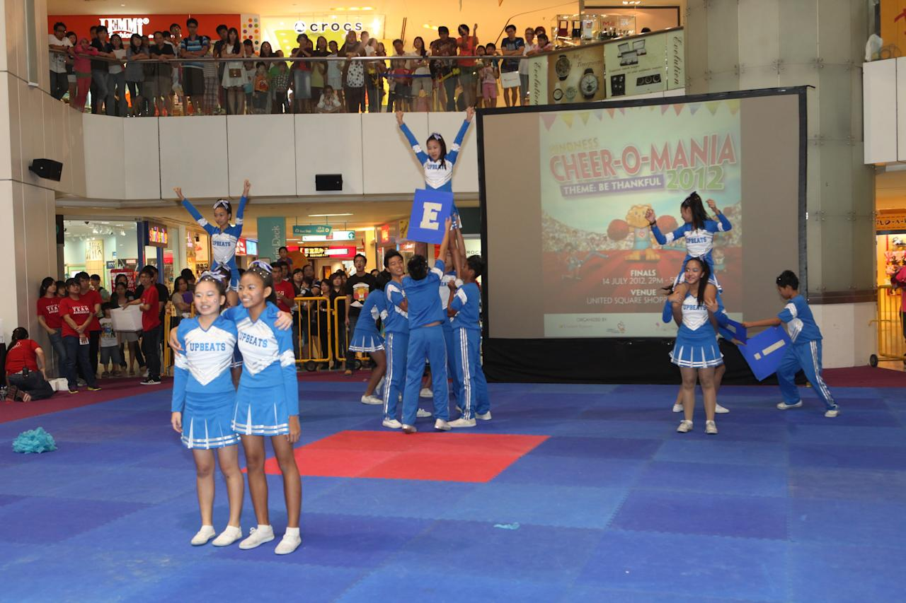 Cheerleading stunts performed by Upbeats, cheerleading squad from Westwood Secondary School.