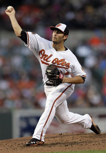 Baltimore Orioles starting pitcher Jake Arrieta throws to the Pittsburgh Pirates in the fourth inning of a baseball game in Baltimore, Wednesday, June 13, 2012. (AP Photo/Patrick Semansky)