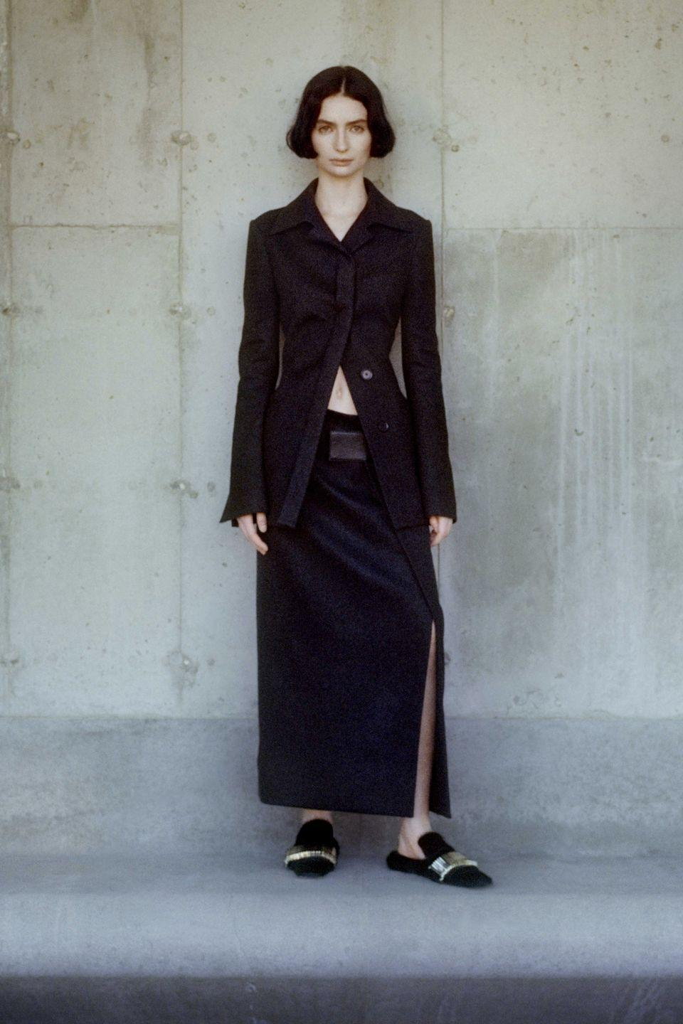 "<p>For AW21, Proenza Schouler aimed to present a ""complete wardrobe created to comfort, inspire, and empower the modern-day woman"".</p><p>Like many designers this season, the team tried to find the perfect balance between reality and optimism, smart and casual. This came about in relaxed tailoring, slinky skirts paired with backless loafers and knitwear given a fun twist in the form of bias-cut dresses and backless tops. Presented via a filmed catwalk show and lookbook, Proenza Schouler tapped one of the most exciting new faces to come out of 2021: <a href=""https://www.harpersbazaar.com/uk/fashion/fashion-news/a35550250/ella-emhoff-proenza-schouler/"" rel=""nofollow noopener"" target=""_blank"" data-ylk=""slk:Vice President Kamala Harris' stepdaughter, Ella Emhoff"" class=""link rapid-noclick-resp"">Vice President Kamala Harris' stepdaughter, Ella Emhoff</a>, who modelled the new collection.</p>"