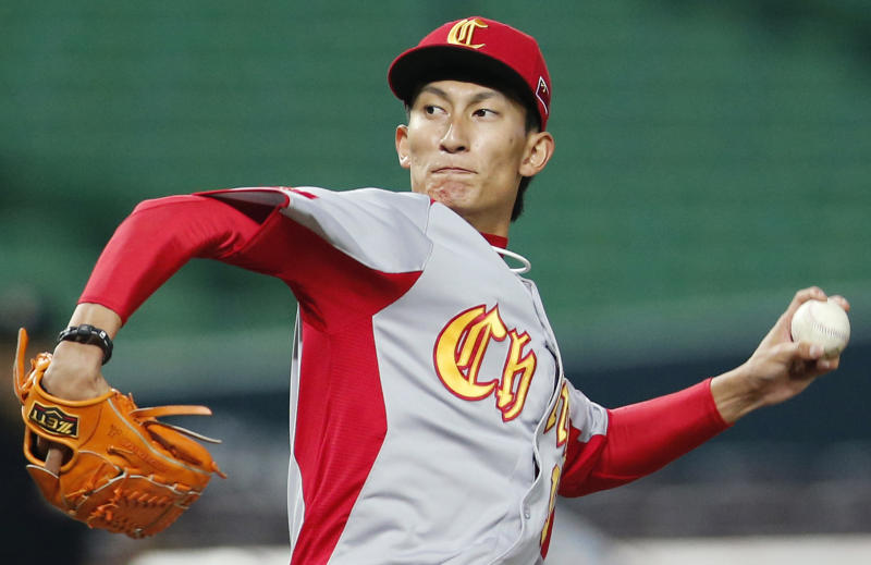China's starter Xin Li delivers a pitch against Cuba in the first inning of their World Baseball Classic first round game in Fukuoka, Japan, Monday, March 4, 2013. (AP Photo/Koji Sasahara)