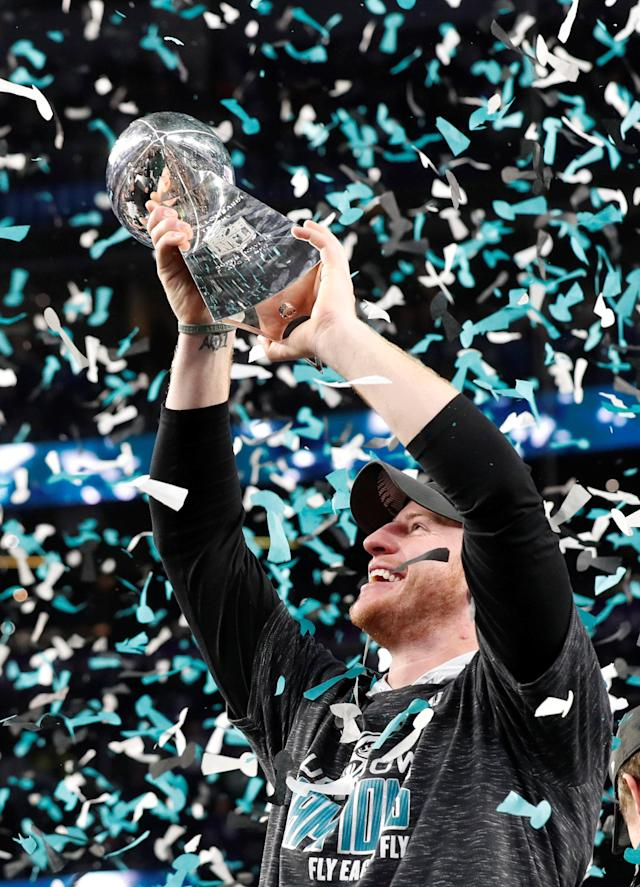 NFL Football - Philadelphia Eagles v New England Patriots - Super Bowl LII - U.S. Bank Stadium, Minneapolis, Minnesota, U.S. - February 4, 2018 Philadelphia Eagles' Carson Wentz celebrates with the Vince Lombardi Trophy after winning Super Bowl LII REUTERS/Kevin Lamarque