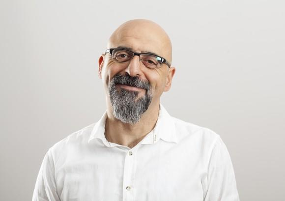 Smiling bald man with glasses and beard