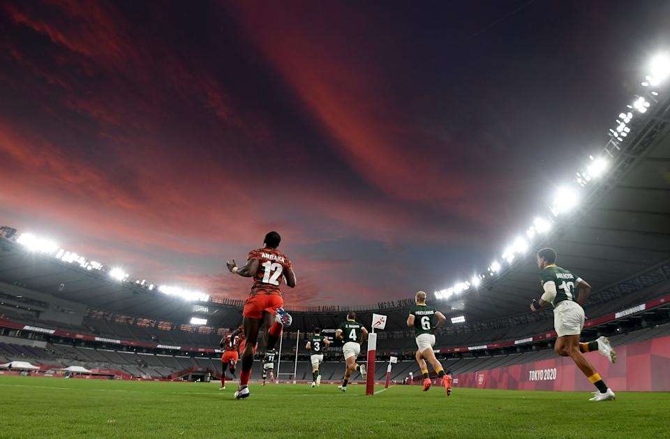 <p>Tokyo , Japan - 26 July 2021; Willy Ambaka of Kenya runs out before the rugby sevens men's pool A match between South Africa and Kenya at the Tokyo Stadium during the 2020 Tokyo Summer Olympic Games in Tokyo, Japan. (Photo By Stephen McCarthy/Sportsfile via Getty Images)</p>