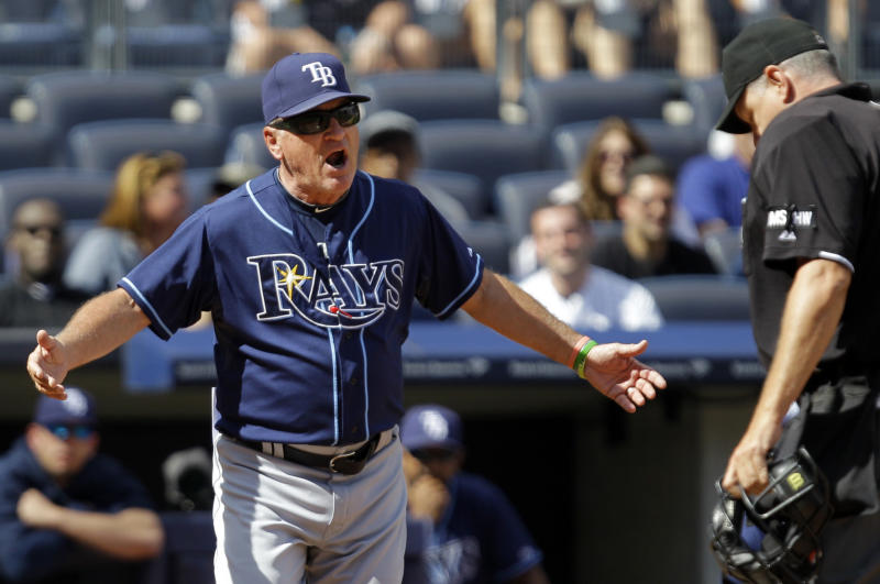 Tampa Bay Rays manager Joe Maddon, left, protests to home plate umpire Paul Emmel after Emmel tossed him from the game in the third inning of a baseball game against the New York Yankees at Yankee Stadium in New York, Sunday, Sept. 16, 2012. (AP Photo/Kathy Willens)