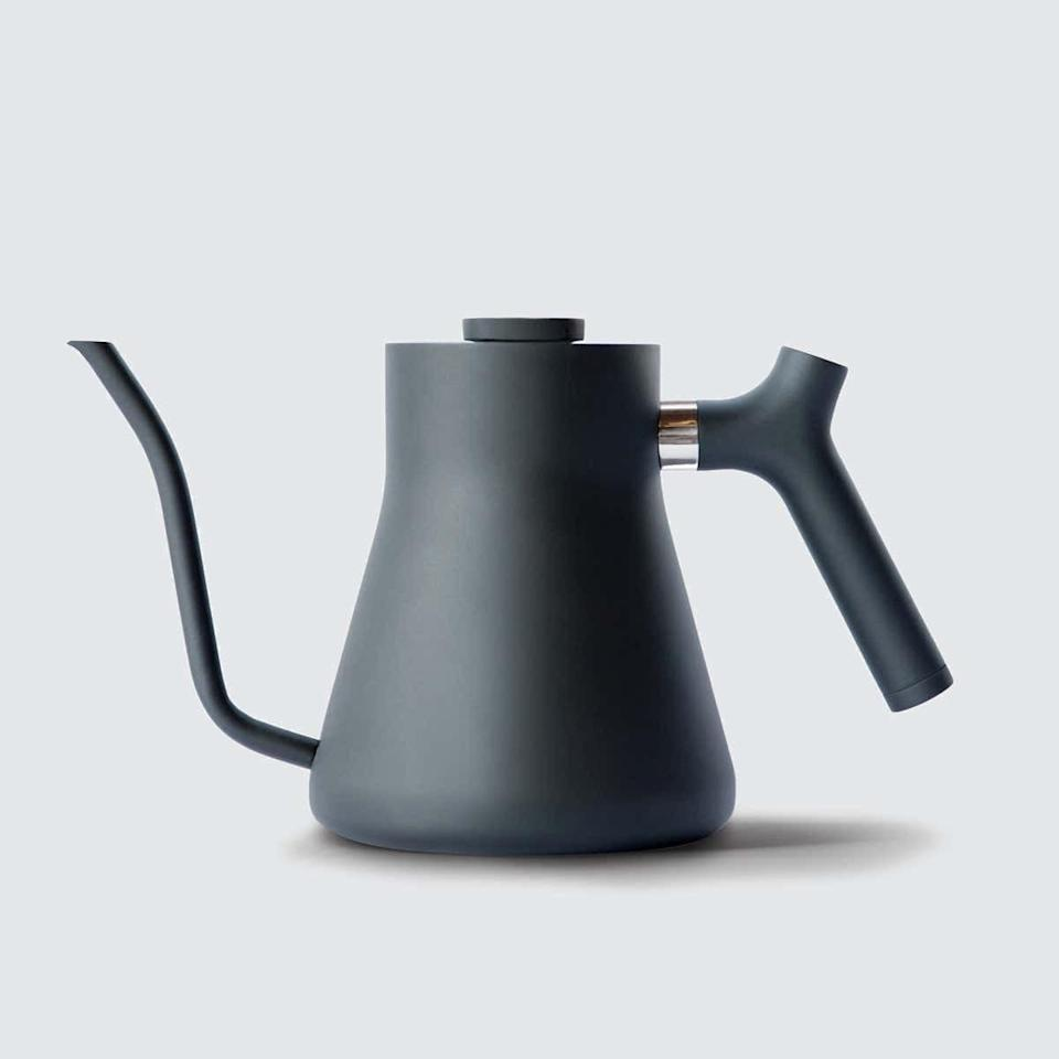 "Does your man have trouble keeping his eyes open on early Zoom calls? Make him a morning person (or closer to it) with this matte black kettle that's high-quality and perfect for pour-over <a href=""https://www.glamour.com/gallery/coffee-subscription-boxes?mbid=synd_yahoo_rss"" rel=""nofollow noopener"" target=""_blank"" data-ylk=""slk:coffee"" class=""link rapid-noclick-resp"">coffee</a>. $79, Verishop. <a href=""https://www.verishop.com/fellow/coffee-machine/stagg-pour-over-kettle/p4465215242263?variant_id=31583322112023"" rel=""nofollow noopener"" target=""_blank"" data-ylk=""slk:Get it now!"" class=""link rapid-noclick-resp"">Get it now!</a>"