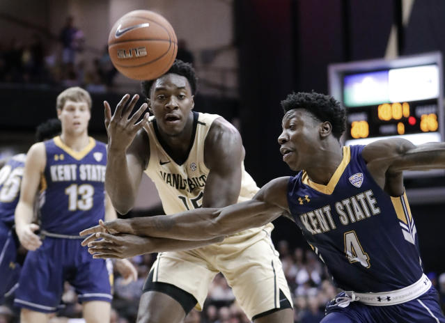 Kent State guard Antonio Williams (4) knocks the ball away from Vanderbilt forward Clevon Brown (15) during the first half of an NCAA college basketball game Friday, Nov. 23, 2018, in Nashville, Tenn. (AP Photo/Mark Humphrey)