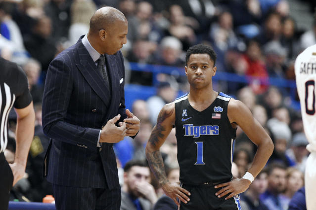 """Memphis head coach Anfernee """"Penny"""" Hardaway, left, talks with Tyler Harris, right, in the second half of an NCAA college basketball game, against Connecticut, Sunday, Feb. 16, 2020, in Hartford, Conn. (AP Photo/Jessica Hill)"""