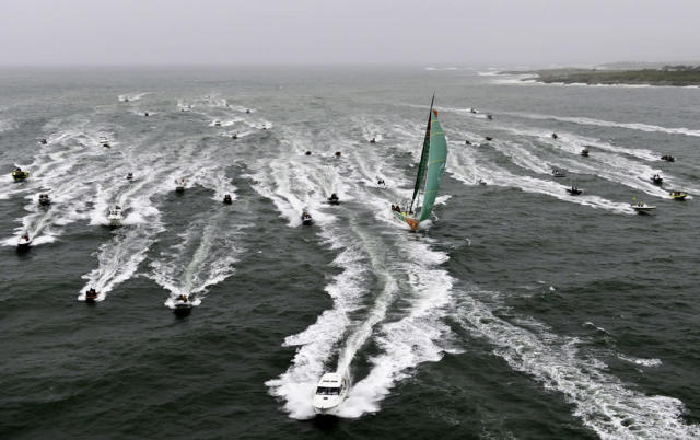 In this photograph provided by the Volvo Ocean Race, Groupama Sailing Team, skippered by Franck Cammas from France, as its followed across the line by a huge spectator fleet, to take first place on leg 8, from Lisbon, Portugal, to Lorient, France, of the Volvo Ocean Race on Friday, June 15, 2012. (AP Photo/Paul Todd/Volvo Ocean Race)