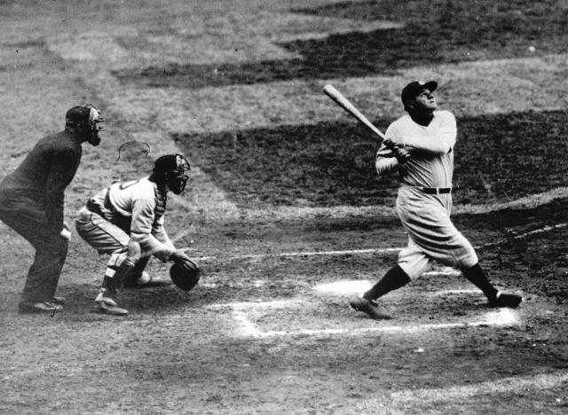 FILE - In this undated file photo, New York Yankees' Babe Ruth hits a home-run. As part of its collection of Babe Ruth items, the Baseball Hall of Fame says it has the bat the slugger used to hit his then-record 60th home run in 1927. (AP Photo/File)