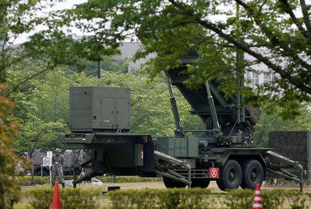 A Japan Self-Defence Forces soldier yawns beside Patriot Advanced Capability-3 (PAC-3) missile at the Defense Ministry in Tokyo, Japan May 31, 2016.  REUTERS/Toru Hanai
