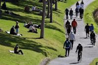 People exercise at a park along the Yarra River in Melbourne a day before lockdown restrictions were to be eased