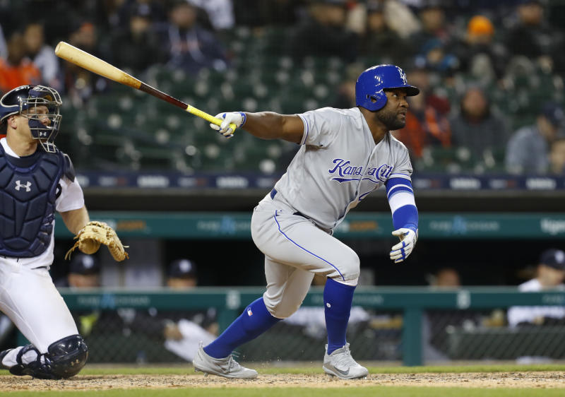Kansas City Royals' Abraham Almonte, right, hits a one-run single against the Detroit Tigers in the ninth inning of a baseball game in Detroit, Friday, April 20, 2018. Ryan Goins scored on the play. (AP Photo/Paul Sancya)