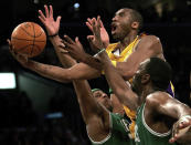 Los Angeles Lakers' Kobe Bryant, top, goes up for a shot between the Boston Celtics' Paul Pierce, left, and Al Jefferson during the first half of an NBA basketball game in Los Angeles, Feb. 23, 2006. Bryant, the 18-time NBA All-Star who won five championships and became one of the greatest basketball players of his generation during a 20-year career with the Los Angeles Lakers, died in a helicopter crash Sunday, Jan. 26, 2020. (AP Photo/Branimir Kvartuc)