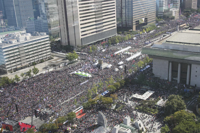 Thousands of demonstrators gather during a rally in Seoul, South Korea, Wednesday, Oct. 9, 2019. Thousands of protesters rallied Wednesday in South Korea's capital for the second consecutive week to call for the ouster of President Moon Jae-in's hand-picked justice minister, whose family is at the center of an investigation into allegations of financial crimes and academic favors. (Kim Seung-doo/Yonhap via AP)