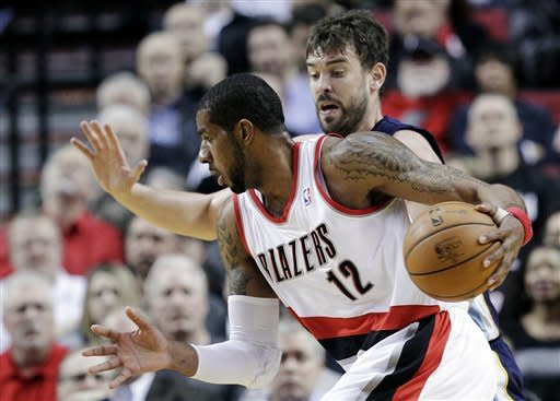 Portland Trail Blazers forward LaMarcus Aldridge, right, drives past Memphis Grizzlies center Marc Gasol, of Spain, during the first quarter of an NBA basketball game in Portland, Ore., Tuesday, March 12, 2013. (AP Photo/Don Ryan)
